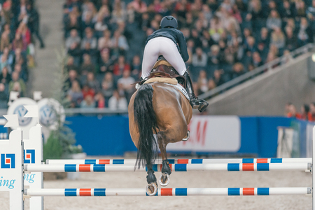 SOLNA, SWEDEN - NOV 27, 2016: Jonna Ekberg at the Friends Christmas Speed Jumping in the Sweden International Horse Show at Friends arena. Editorial