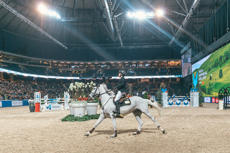 SOLNA, SWEDEN - NOV 27, 2016: Douglas Lindelow at the Champion of the youngsters final in the Sweden International Horse Show at Friends arena.