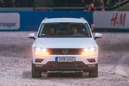 vw: SOLNA, SWEDEN - NOV 27, 2016: Winner Nicola Philippaerts driving the VW prize car at the Friends Christmas Speed Jumping in the Sweden International Horse Show at Friends arena. Editorial