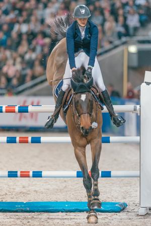 SOLNA, SWEDEN - NOV 27, 2016: Sweden Grand Prix in the Sweden International Horse Show at Friends arena. Editorial