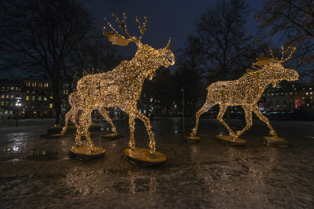 stock photo stockholm sweden dec 13 2016 group of christmas moose made of led lights at nybrokajen