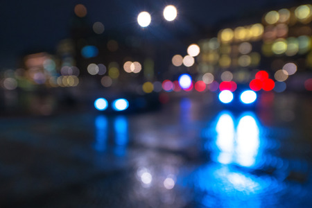 Defocused cars during night with colorful lights and reflections from the wet street. Sweden Stock Photo