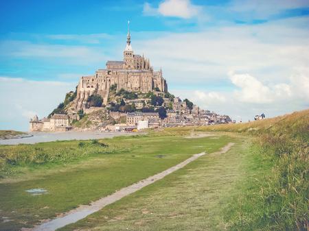 st michel: MONT SAINT MICHEL, FRANCE - AUG 1, 2007: The monestry Mont Saint Michel during a clear autumn day.