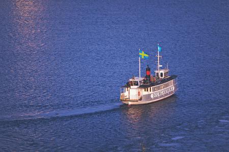 STOCKHOLM, SWEDEN, JAN 20: The boat Djurgardsfarjan during winter in eveninglight