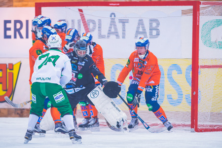 bandy: STOCKHOLM, SWEDEN, JAN 22: Hammarby scores at the bandy game between Hammarby and Bollnas. Hammarby won with 6-1 at Zinkensdamm