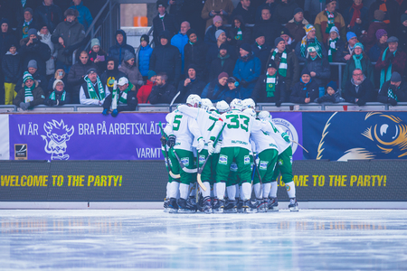 bandy: STOCKHOLM, SWEDEN, JAN 22: Hammarby peptalk before the gandy game between Hammarby and Bollnas. Hammarby won with 6-1 at Zinkensdamm