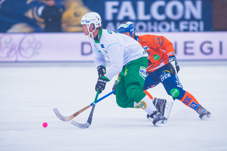 bandy: STOCKHOLM, SWEDEN, JAN 22: Pizzoni Elfving and Hellmyrs at the bandy game between Hammarby and Bollnas. Hammarby won with 6-1 at Zinkensdamm