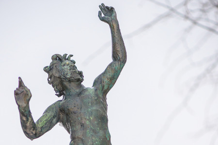 STOCKHOLM, SWEDEN, FEB 22, 2017: Sculpture in bronze of dancing faun by unknown artist at Prince Eugens Waldermarsudde during snowy weather.
