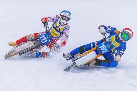 NORRTALJE, SWEDEN, FEB 26, 2017: Two iceracing Racers during the Swedish national championships at HZ Bygg Arena in Hallstavik.
