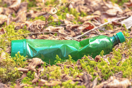 Plastic bottle or PET thrown in nature as garbage. Sweden Stock Photo