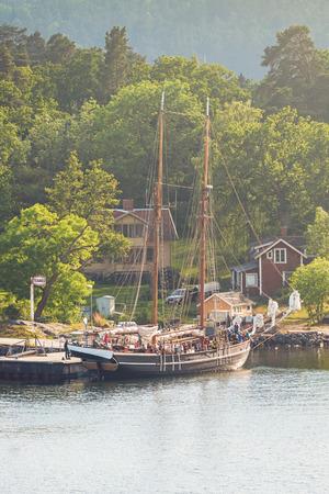STOCKHOLM, SWEDEN - JUNE 19, 2016: Children away on summercamp on a big sailing ship in the swedish archipelago outside of Stockholm.