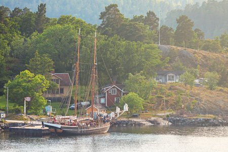 embarked: STOCKHOLM, SWEDEN - JUNE 19, 2016: Children away on summercamp on a big sailing ship in the swedish archipelago outside of Stockholm.