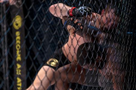 STOCKHOLM, SWEDEN - APRIL 1, 2017: MMA fight between Alexander Bergman vs Roggy Lawson at Superior Challenge 15 at Eriksdalshallen in Stockholm. Bergman won by decision Editorial