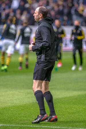 warming up: SOLNA, SWEDEN - APRIL 17, 2017: Referee Jonas Eriksson warming up at the national stadium Friends Arena in Solna. Hammarby won with 2-1