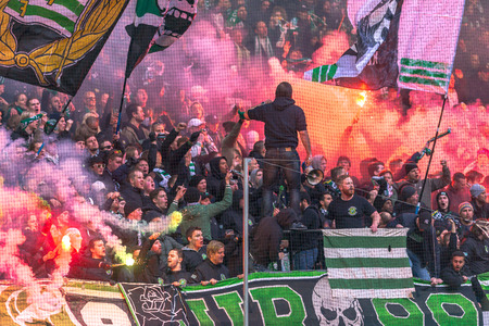 SOLNA, SWEDEN - APRIL 17, 2017: Hammarby fans at the derby match between AIK and Hammarby IF at the national stadium Friends Arena in Solna. Hammarby won with 2-1