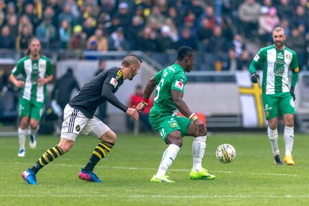 amat: SOLNA, SWEDEN - APRIL 17, 2017: Pa Dibba at the derby match between AIK and Hammarby IF at the national stadium Friends Arena in Solna. Hammarby won with 2-1 Editorial