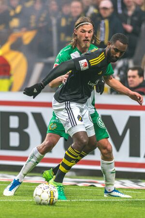 SOLNA, SWEDEN - APRIL 17, 2017: Bjorn Paulsen and Henok Goitom at the derby game between AIK and Hammarby IF at the national stadium Friends Arena in Solna. Hammarby won with 2-1