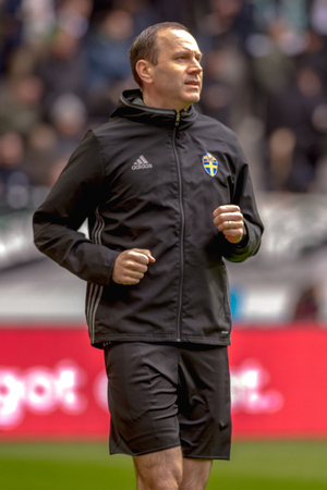 SOLNA, SWEDEN - APRIL 17, 2017: Referee Jonas Eriksson warming up at the national stadium Friends Arena in Solna. Hammarby won with 2-1