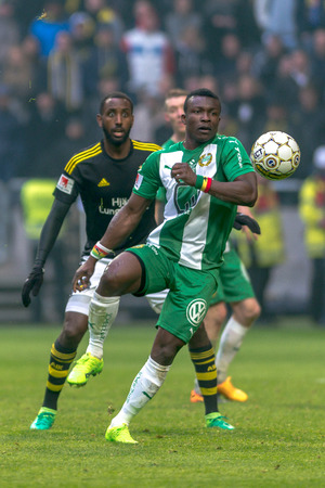 SOLNA, SWEDEN - APRIL 17, 2017: Henok Goitom and Pa Dibba at the derby game between AIK and Hammarby IF at the national stadium Friends Arena in Solna. Hammarby won with 2-1 Editorial