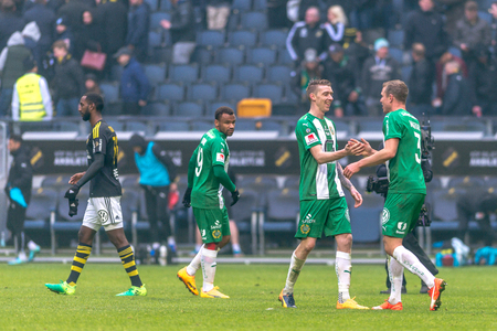 SOLNA, SWEDEN - APRIL 17, 2017: Hammarby players happy after the victory in the derby game between AIK and Hammarby IF at the national stadium Friends Arena in Solna. Hammarby won with 2-1