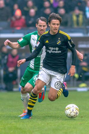 bandera de suecia: SOLNA, SWEDEN - APRIL 17, 2017: Simon Thern at the derby match between AIK and Hammarby IF at the national stadium Friends Arena in Solna. Hammarby won with 2-1