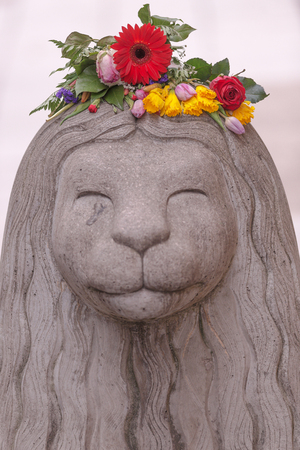 STOCKHOLM, SWEDEN - APRIL 16, 2017: Flowers on the head of an concrete lion on Drottninggatan after the terror attack on the 7th of april.