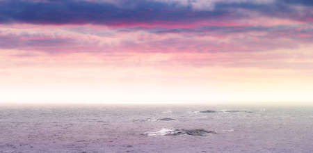 Partly cloudy panorama in vivid colors at seashore with small islets in the sea. Sweden Stock Photo