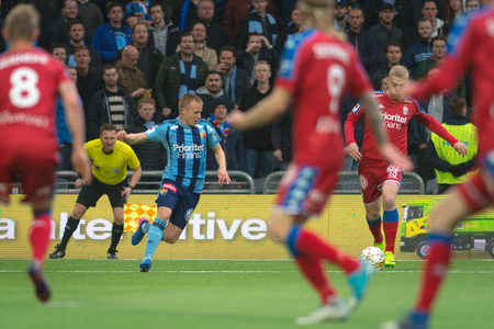 STOCKHOLM, SWEDEN - MAY 15, 2017: Henrik Bjordal chased by a DIF player at the match between Djurgarden IF and IFK Goteborg at the Tele2 arena. DIF won with 1-0 Editorial
