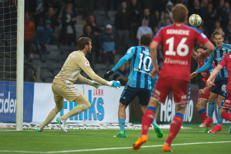 STOCKHOLM, SWEDEN - MAY 15, 2017: Andreas Isaksson saves in the match between Djurgarden IF and IFK Goteborg at the Tele2 arena. DIF won with 1-0 Editorial