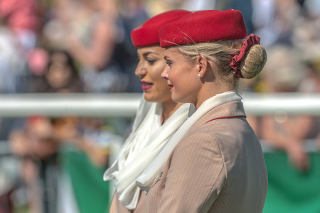 personel: STOCKHOLM, SWEDEN - JUN 6, 2017: Two female cabin personel from Emirates at Nationaldagsgaloppen at Gardet. Editorial