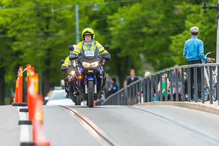 STOCKHOLM, SWEDEN - JUNE 3, 2017: Police escort by motorcycle at the Stockholm Marathon. About +13k started