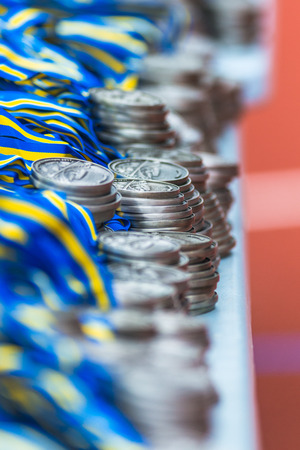 STOCKHOLM, SWEDEN - JUNE 3, 2017: Piles of medals at the Stockholm Marathon. About +13k started