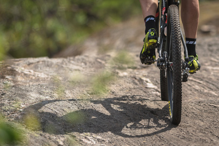 TULLINGE, SWEDEN - JUN 11, 2017: Behind a MTB rider at the mountainbike event Lida Loop in the forests outside of Stockholm.
