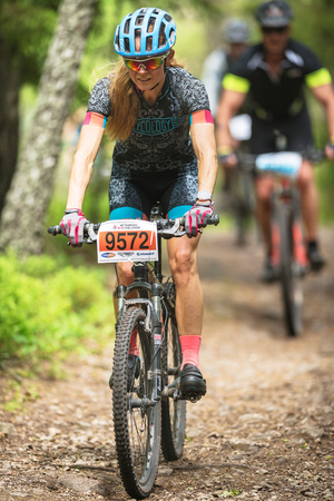 mtb: TULLINGE, SWEDEN - JUN 11, 2017: Female rider at the MTB event Lida Loop in the forests outside of Stockholm. Editorial
