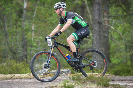 TULLINGE, SWEDEN - JUN 11, 2017: Sideview of MTB racers at the mountainbike event Lida Loop in the forests outside of Stockholm. Editorial