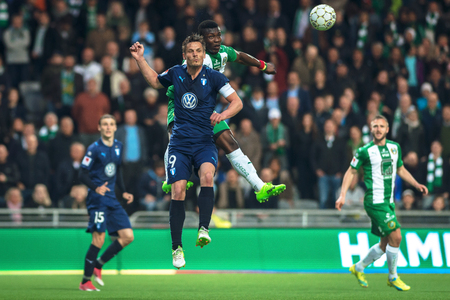 STOCKHOLM, SWEDEN - MAY 17, 2017: Markus Rosenberg in a duel at the match between Hammarby IF and Malmo FF at the Tele2 arena. Result 1-1