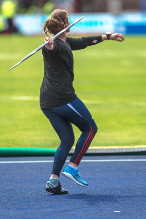 are thrust: STOCKHOLM, SWEDEN - JUNE 18, 2017:  Female javelin warmup at the IAAF Diamond League in Stockholm. Editorial