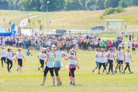 fmale: STOCKHOLM, SWEDEN - JULY 22, 2017: Color obstacle rush at Gardet in Stockholm. 15 obstacles, 6 colors and 5k running.