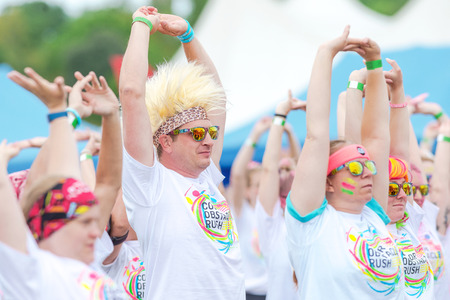 fmale: STOCKHOLM, SWEDEN - JULY 22, 2017: Man with mohikan wig at the color obstacle rush at Gardet in Stockholm. 15 obstacles, 6 colors and 5k running.