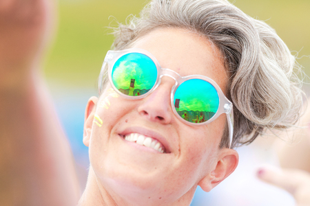 fmale: STOCKHOLM, SWEDEN - JULY 22, 2017: Female selfie face at the color obstacle rush at Gardet in Stockholm. 15 obstacles, 6 colors and 5k running.