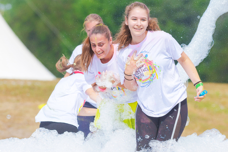 STOCKHOLM, SWEDEN - JULY 22, 2017: Mother with doughters at the color obstacle rush at Gardet in Stockholm. 15 obstacles, 6 colors and 5k running.