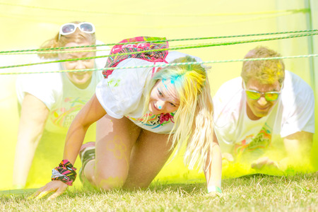 fmale: STOCKHOLM, SWEDEN - JULY 22, 2017: Yellow station at the color obstacle rush at Gardet in Stockholm. 15 obstacles, 6 colors and 5k running. Editorial