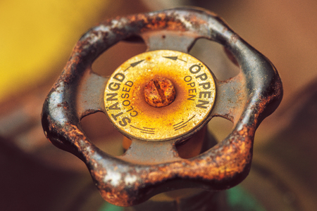 Pressure valve rusty and worn down in colorful colors. Text in Swedish and english Stock Photo