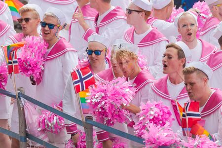 STOCKHOLM SWEDEN, 5 AUG, 2017: Norweigian choir called the Faggots at the pride parade in Stockholm with happy people and waving flags. Aprox 45 000 participants in the parade. Editorial