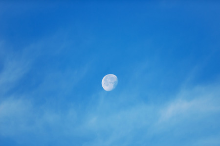 Moon with light clouds in its waning gibbous phase during daytime. Sweden