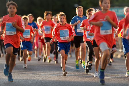 STOCKHOLM, SWEDEN - AUG 19, 2017: Midnight run or Midnattsloppet for kids at the streets of Stockholm. 2 km
