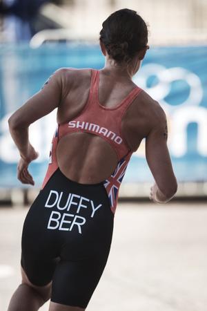 STOCKHOLM, SWEDEN - AUG 26, 2017: Winner Flora Duffy (BER) leading the running at the womens ITU triathlon series. Female Olympic distance.