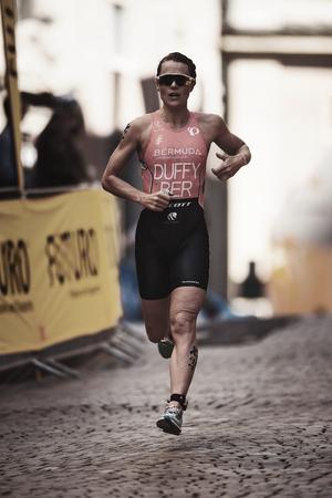 elite: STOCKHOLM, SWEDEN - AUG 26, 2017: Flora Duffy (BER) running at the womens ITU triathlon series. Winner of the 2017 triathlon in Stockholm Editorial