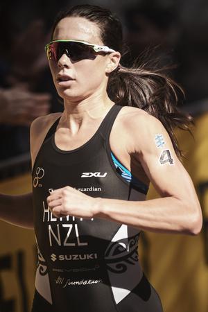 elite: STOCKHOLM, SWEDEN - AUG 26, 2017: Closup of Andrea Hewitt (NZL) running at the womens ITU triathlon series. Female Olympic distance.