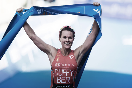 STOCKHOLM, SWEDEN - AUG 26, 2017: Winner Flora Duffy (BER) breaking the finish line at the womens ITU triathlon series. Female Olympic distance. Editorial